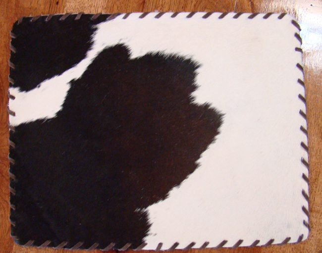 Cowhide Placemat with Leather Lace